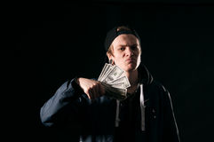 Young man with money in his hands Royalty Free Stock Images