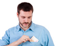Young man with money in his pocket Stock Photo