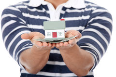 Young man with money and house's model. Royalty Free Stock Photography