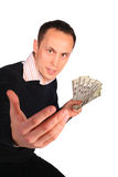 Young man with money invites Royalty Free Stock Photography