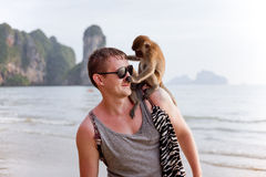 Young man with monkey on his shoulder Royalty Free Stock Photos