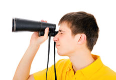 Young Man with a Monocle. Young Man with Monocle Spying for Someone on the White Background Stock Photos
