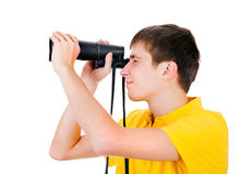 Young Man with a Monocle. Young Man with Monocle Spying for Someone on the White Background Royalty Free Stock Photography