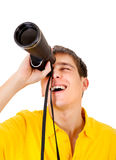 Young Man with a Monocle. Surprised Young Man with Monocle Spying for Someone on the White Background Stock Images