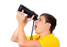Young Man with a Monocle. Surprised Young Man with Monocle Spying for Someone on the White Background Stock Photography