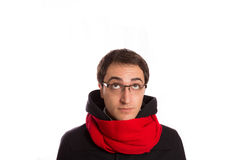 Young man with montgomery and red scarf  looks up ,  isolated on Royalty Free Stock Photo