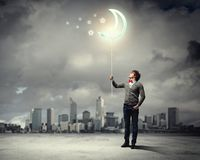 Young man and the moon symbol Royalty Free Stock Photography