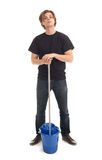 Young man with mop and bucket Royalty Free Stock Images