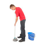 Young man with mop and bucket Royalty Free Stock Photos
