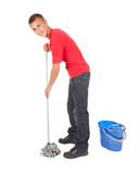 Young man with mop and bucket Royalty Free Stock Photography
