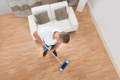 Young Man Mopping Floor Stock Images
