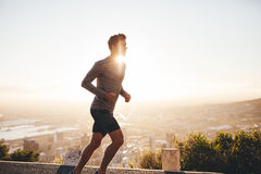 Young man on morning run Stock Image