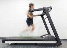 Young man in motion on a treadmill in the gym. Image of young man in motion on a treadmill in the gym Royalty Free Stock Image