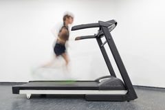 Young man in motion on a treadmill in the gym. Image of young man in motion on a treadmill in the gym Stock Images