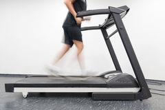 Young man in motion on a treadmill in the gym. Image of young man in motion on a treadmill in the gym Royalty Free Stock Photography