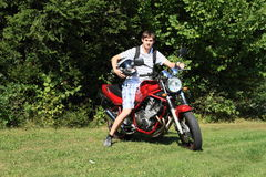 Young man on motorbike Stock Photo