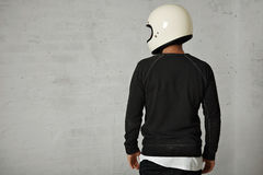 Young man with motorcycle helmet Royalty Free Stock Photography