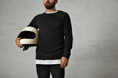 Young man with motorcycle helmet Stock Image