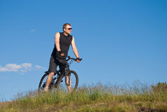 Young man on a mountain bike Stock Photos