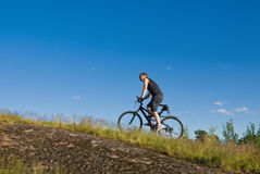 Young man on a mountain bike Stock Image