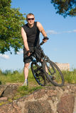 Young man on a mountain bike Royalty Free Stock Photo