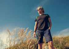Young man on mountain hill Stock Photography