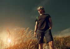 Young man on mountain hill Royalty Free Stock Photography