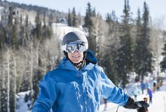 Young Man on Mountain at a Resort in Colorado Ready to Ski. With all Safety Equipment Stock Photo