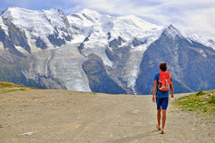 Young man on mountain road Stock Image