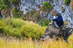 Young man on mountain rock Stock Image