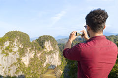 Young Man Mountains Take Photo Of Landscape On Cell Smart Phone Asian Holiday Stock Photo