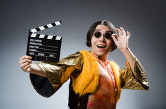 The young man with movie board Royalty Free Stock Images