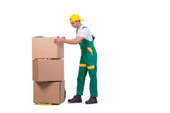 The young man moving boxes with cart isolated on white Stock Photography