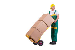 The young man moving boxes with cart isolated on white Royalty Free Stock Images