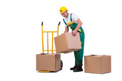 The young man moving boxes with cart isolated on white Royalty Free Stock Photography