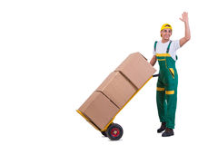 The young man moving boxes with cart isolated on white Royalty Free Stock Image