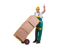 The young man moving boxes with cart isolated on white Stock Photo