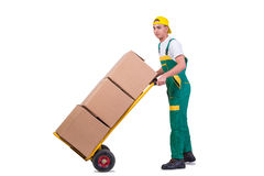 The young man moving boxes with cart isolated on white Royalty Free Stock Photos