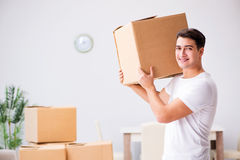 The young man moving boxes at home Stock Images