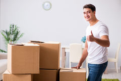 The young man moving boxes at home Royalty Free Stock Photography