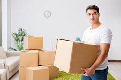 The young man moving boxes at home Stock Photos