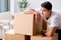The young man moving boxes at home Royalty Free Stock Images