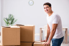 The young man moving boxes at home Royalty Free Stock Photo