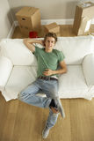 Young Man Moving Into New Home Royalty Free Stock Images