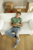 Young Man Moving Into New Home Stock Image