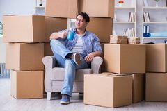 The young man moving in to new house with boxes Stock Image
