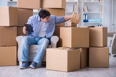 The young man moving in to new house with boxes Royalty Free Stock Image