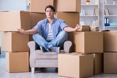 The young man moving in to new house with boxes Royalty Free Stock Photos