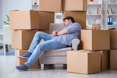 The young man moving in to new house with boxes Royalty Free Stock Photography