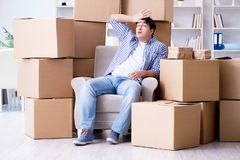 The young man moving in to new house with boxes. Young man moving in to new house with boxes Royalty Free Stock Photography